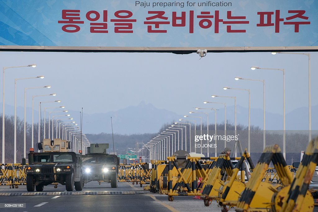 Military humvees pass through the Tongil bridge, a checkpoint leading to the Kaesong joint industrial zone, in Paju on February 11, 2016. South Korea said it would suspend operations at the Kaesong joint industrial complex in North Korea to punish Pyongyang for its latest rocket launch and nuclear test. / AFP / ED JONES