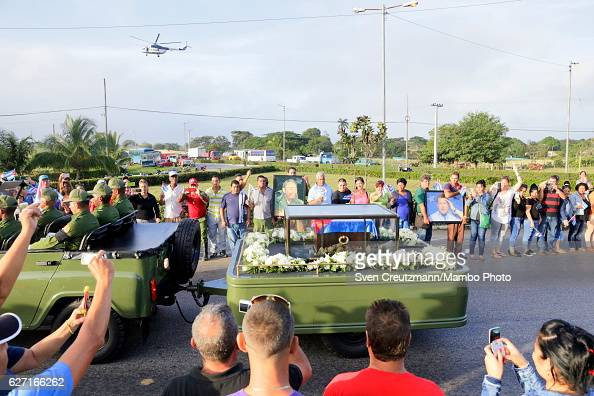 A military jeep pulls a trailer with the flag draped chest containing the remains of former President Fidel Castro on the third day of a 4 day...