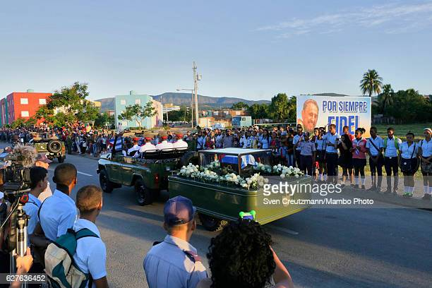 A military jeep pulls a trailer with the flag draped chest containing the remains of former President Fidel Castro as heading for the cemetery on...