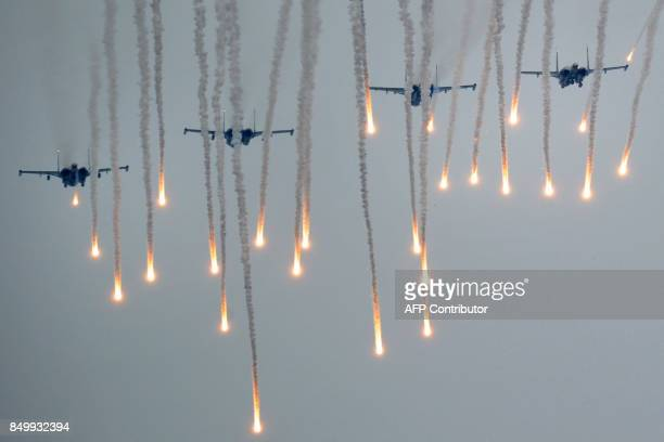 TOPSHOT Military jets fly during the joint RussianBelarusian military exercises Zapad2017 at a training ground near the town of Borisov on September...