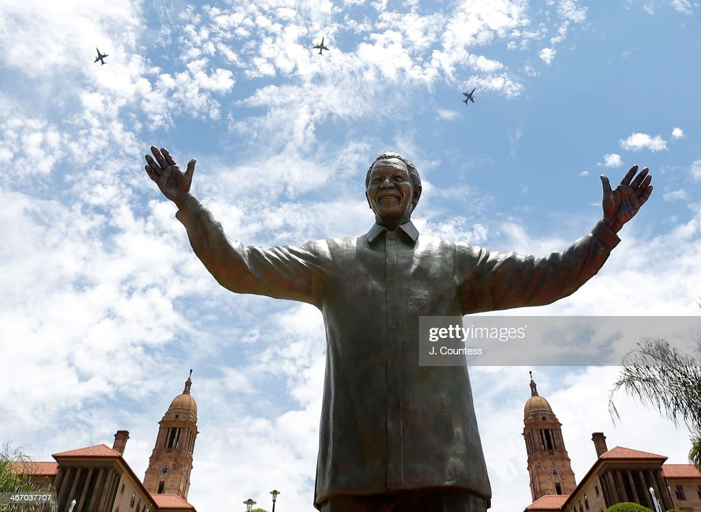 Military jets 'fly-over' the newly unveiled statue of former South African president Nelson Mandela at the Union Buildings on December 16, 2013 in Pretoria, South Africa. The statue was unveiled on the day after the burial of Nelson Mandela in his home village of Qunu on December 15, 2013. Nelson Mandela passed away on the evening of December 5, 2013 at his home in Houghton at the age of 95. Mandela became South Africa's first black president in 1994 after spending 27 years in jail for his activism against apartheid in a racially-divided South Africa. December 16 is celebrated in South Africa as Reconciliation Day and marks several significant events in South African history.