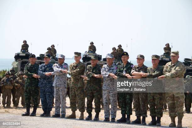SATTAHIP CHONBURI THAILAND Military Leaders cross hands on the beach head during the USThai joint military exercise titled 'Cobra Gold' on Hat Yao...
