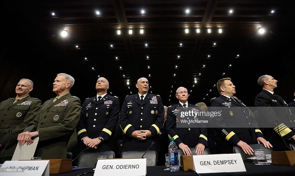U.S. military leaders, including all six members of the Joint Chiefs of Staff, (L-R) Staff Judge Advocate to the Commandant of the Marine Corps Maj. Gen. Vaughn Ary; Commandant of the Marine Corps Gen. James Amos; Judge Advocate General of the Army Lt. Gen. Dana Chipman; Chief of Staff of the Army Gen. Raymond Odierno; Chairman of the Joint Chiefs of Staff Gen. <a gi-track='captionPersonalityLinkClicked' href=/galleries/search?phrase=Martin+Dempsey&family=editorial&specificpeople=2116621 ng-click='$event.stopPropagation()'>Martin Dempsey</a>; Legal Counsel to the Chairman of the Joint Chiefs of Staff Brig. Gen. Richard Gross; Chief of Naval Operations Adm. Jonathan Greenert appear before the Senate Armed Services Committee on pending legislation regarding sexual assaults in the military June 4, 2013 in Washington, DC. A recent survey of active duty personnel by the Pentagon revealed that 6.1 percent of women and 1.2 percent of men reported receiving 'unwanted sexual contact' in the past year.