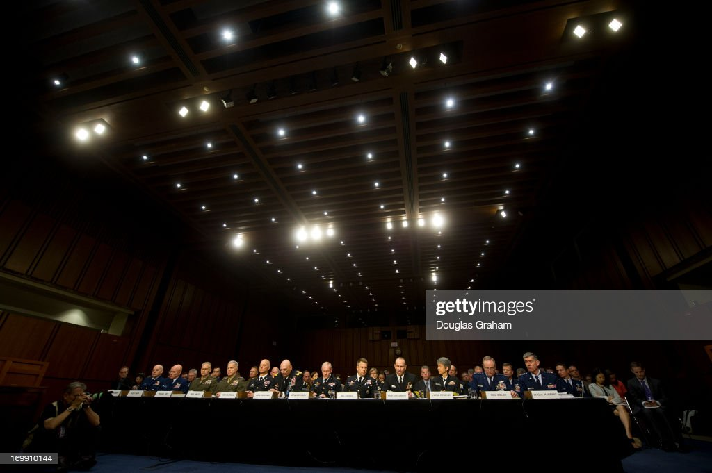 U.S. military leaders, including all six members of the Joint Chiefs of Staff, testify before the Armed Services Committee hearing on pending legislation regarding sexual assaults in the military in the Senate Hart Office Building on June 4, 2013. At witness table from L to R; Judge Advocate General of the Coast Guard Rear Adm. Frederick Kenney Jr.; Commandant of the Coast Guard Adm. Robert Papp Jr.; Staff Judge Advocate to the Commandant of the Marine Corps Maj. Gen. Vaughn Ary; Commandant of the Marine Corps Gen. James Amos; Judge Advocate General of the Army Lt. Gen. Dana Chipman; Chief of Staff of the Army Gen. Raymond Odierno; Chairman of the Joint Chiefs of Staff Gen. Martin Dempsey; Legal Counsel to the Chairman of the Joint Chiefs of Staff Brig. Gen. Richard Gross; Chief of Naval Operations Adm. Jonathan Greenert; Judge Advocate General of the Navy Vice Adm. Nanette DeRenzi; Chief of Staff of the Air Force Gen. Mark Welsh III; and Judge Advocate General of the Air Force Lt. Gen. Richard Harding.