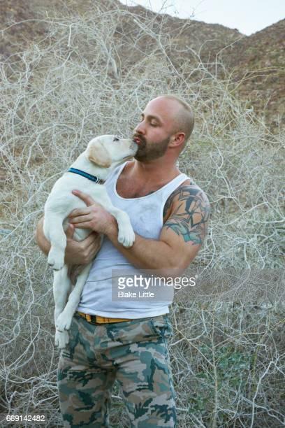 Military Man Holding Dog Profile