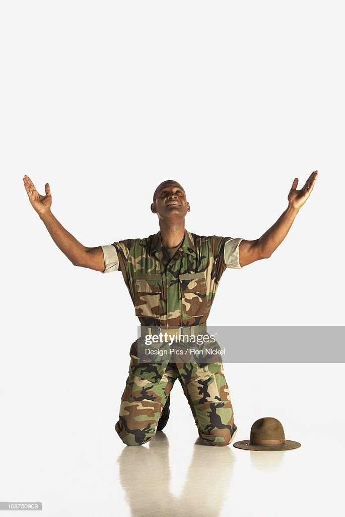 A Military Man With Arms In The Air And Looking Upwards : Stock Photo