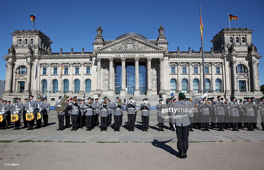 A military marching band performs prior to a swearing-in ceremony for new recruits of the Bundeswehr, the armed forces of the Federal Republic of Germany, in front of the Reichstag building on July 20, 2013 in Berlin, Germany. In the annual ceremony, new soldiers take office on the anniversary of the assassination attempt on Adolf Hitler by Claus Schenk Graf von Stauffenberg.