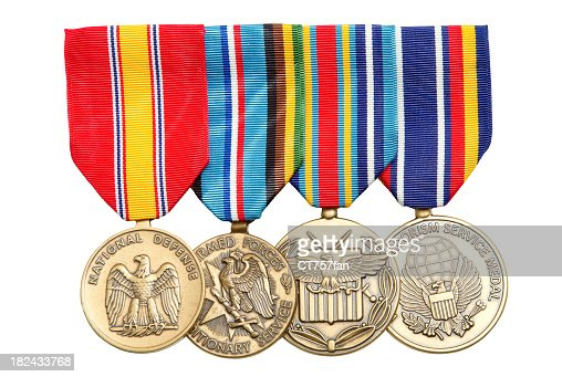 4 Military medals hanging on colorful ribbons