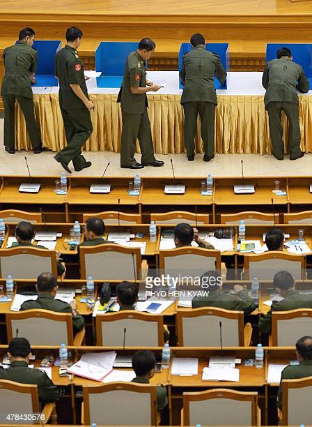Military members of parliament cast their votes on a draft amendment to the constitution at a session of parliament in Naypyidaw on June 25 2015...