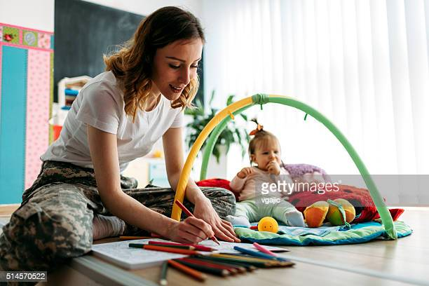 Military Mom Coloring Book With Her Baby