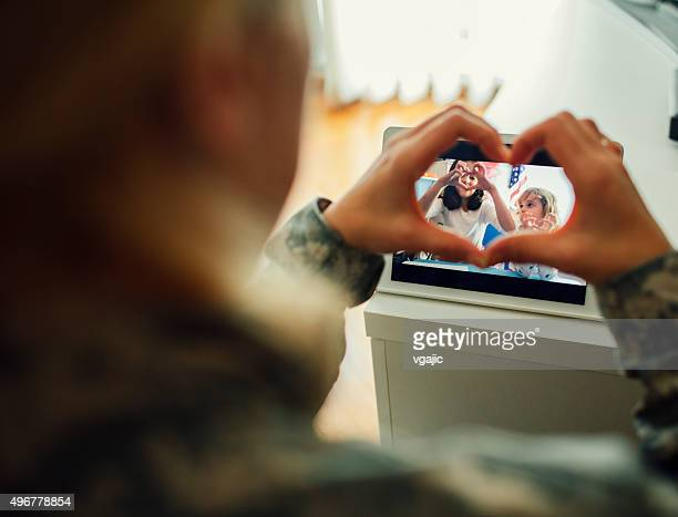 Military Mom Talking With Her Children Over Tablet.