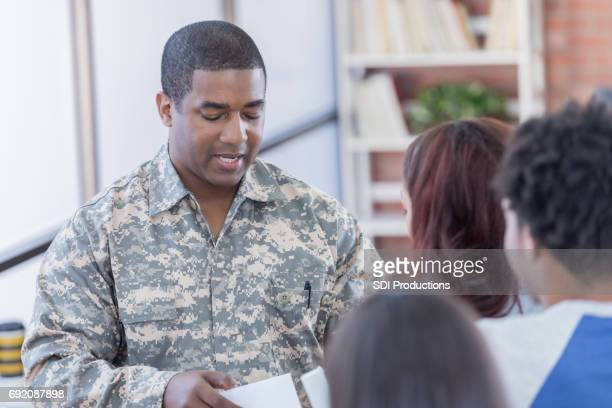 Military officer addresses students at recruitment event