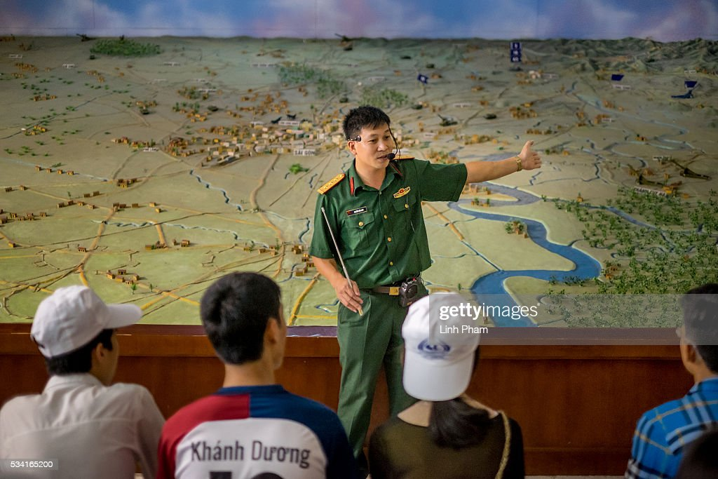 A military officer introduces the maquette of battle of Saigon to Vietnamese students at Vietnam Military History Museum on May 25, 2016 in Hanoi, Vietnam. U.S. President Obama made his historic visit to Vietnam on May 23 with an aim to strengthen the strategic and economic relationship between both countries four decades after the Vietnam war. During the visit, Obama announced the U.S. will fully lift its embargo on weapons and raised issues related to human rights while speaking to the youths on freedom of expression.