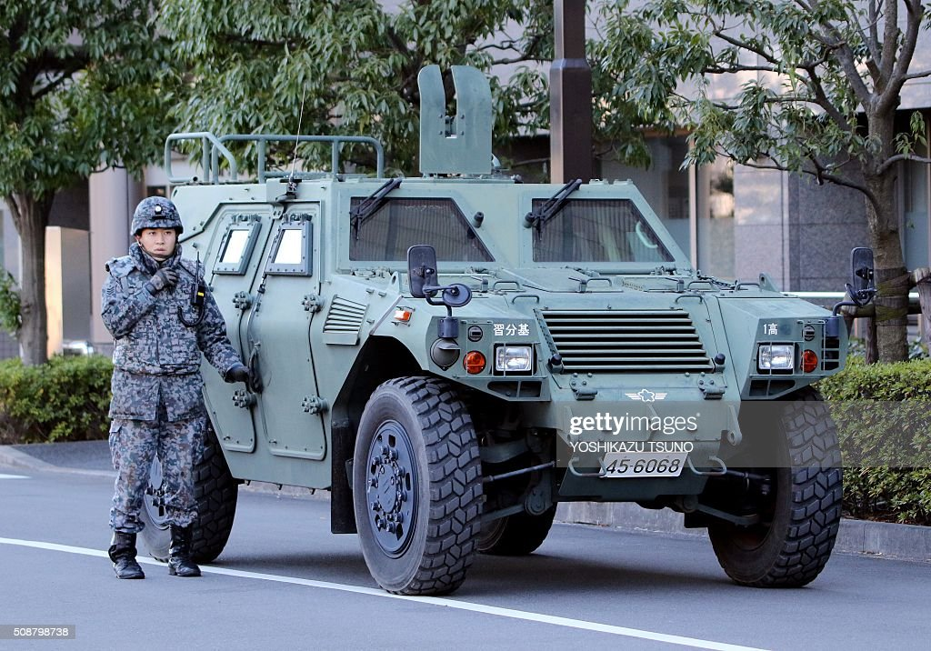 A military officer stands by near Japanese Self-Defense Force's Patriot Advanced Capability-3 (PAC-3) interceptors launchers (not pictured) deployed at Defence Ministry headquarters in Tokyo on February 7, 2016. North Korea launched a long-range rocket on February 7, violating UN resolutions and doubling down against an international community already determined to punish Pyongyang for a nuclear test last month. AFP PHOTO / Yoshikazu TSUNO / AFP / YOSHIKAZU TSUNO