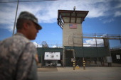 A military officer stands near the entrance to Camp VI at the US military prison for 'enemy combatants' on June 25 2013 in Guantanamo Bay Cuba...