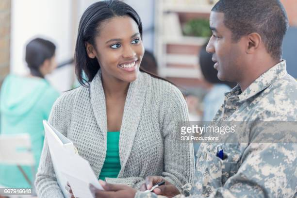 Military officer talks with student about enlistment