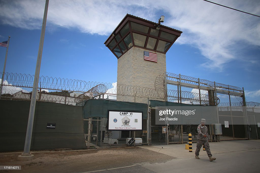 A military officer walks from the entrance to Camp VI at the US military prison for 'enemy combatants' on June 25 2013 in Guantanamo Bay Cuba...