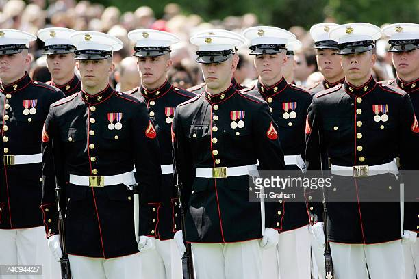 Military officers of the Army Navy and Airforce wait for HM Queen Elizabeth II's inspection on the White House lawn on May 7 2007 in Washington DC...