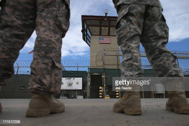 Military officers stand at the entrance to Camp VI and V at the US military prison for 'enemy combatants' on June 25 2013 in Guantanamo Bay Cuba...