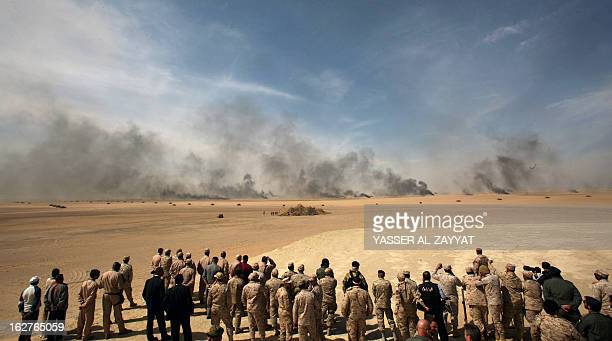Military officers watch a military exercise at Udaira military range 140 km North of Kuwait City on February 26 as part of joint GCC military...