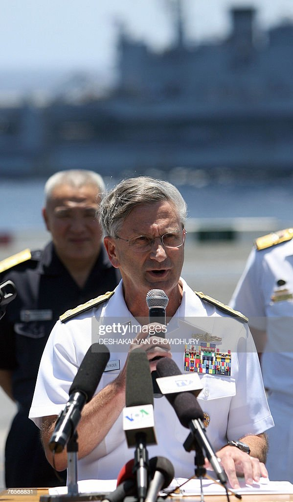 US military official Vice Admiral William Douglas Crowder addresses the media during a press conference on US super-carrier USS Kitty Hawk in the Bay of Bengal, during the Malabar exercise, 07 September 2007. Twenty-seven ships and submarines from the United States, Australia, Japan and Singapore have joined seven from host India off the Andamans archipelago in the Bay of Bengal for six-day manoeuvres in the international exercises, codenamed Malabar, which started on the 04 September. AFP PHOTO/Deshakalyan CHOWDHURY