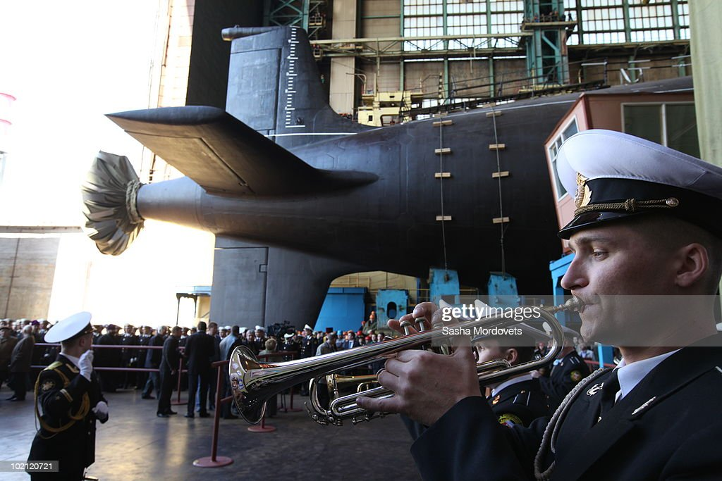 A military orchestra plays during a ceremony to launch the multipurpose nuclear submarine 'Severodvinsk' at the Sevmash shipyard June 15, 2010 in the Northern Russian city of Severodvinsk in Arkhanguelsk region, Russia. The 'Severodvinsk' submarine, which carries 24 cruise missiles, was launched after a short delay caused by technical reasons.