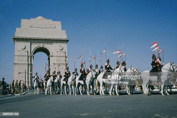 A military parade past India Gate on the Rajpath in Delhi India possibly the Delhi Republic Day parade circa 1965