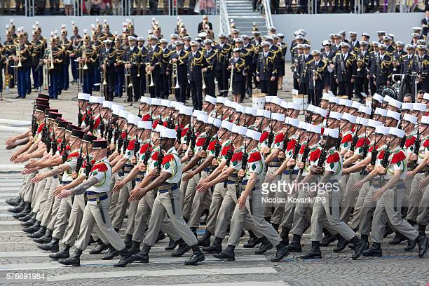 Military parades march past members of the government at the ceremony of Bastille Day on the Champs Elysees on July 14 2016 in Paris France