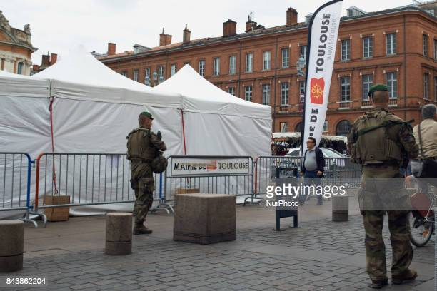 A military patrol on the Place du Capitole the main square of Toulouse For the 'Big Liquidation Sale' French town of Toulouse beef up security with...