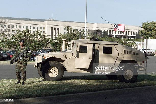 S military personal guard an entrance to the Pentagon during a Memorial Service October 11 2001 in Arlington VA
