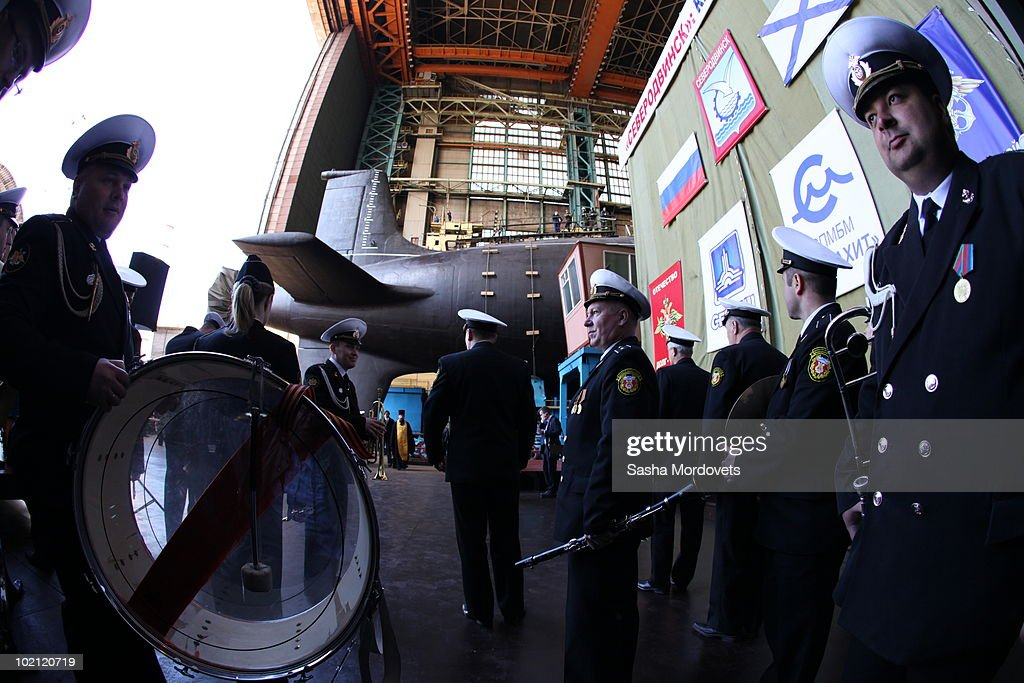 Military personnel a ceremony to launch the multipurpose nuclear submarine 'Severodvinsk' at the Sevmash shipyard June 15, 2010 in the Northern Russian city of Severodvinsk in Arkhanguelsk region, Russia. The 'Severodvinsk' submarine, which carries 24 cruise missiles, was launched after a short delay caused by technical reasons.
