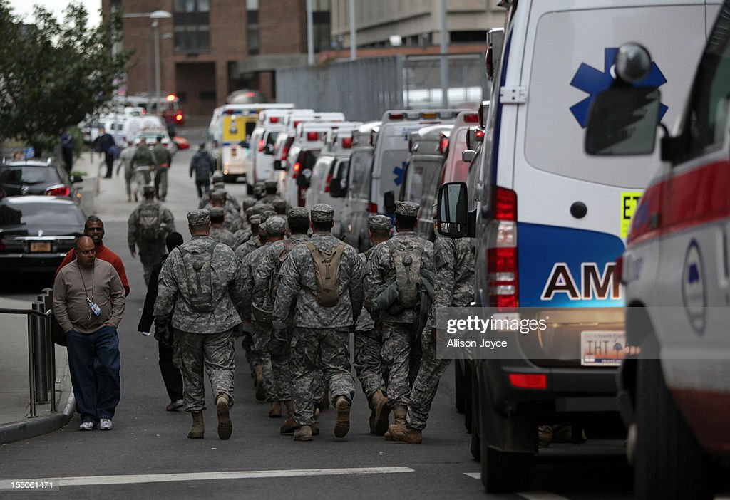 Military personnel aid during an evacuation of Bellevue Hospital October 31, 2012 in New York City. The hospital had been operating on backup generators since losing power during Hurricane Sandy but had to be evacuated once the extent of the damage became clear. The storm has claimed several dozen lives in the United States and has caused massive flooding across much of the Atlantic seaboard. U.S. President Barack Obama has declared the situation a 'major disaster' for large areas of the U.S. east coast, including New York City, with widespread power outages and significant flooding in parts of lower Manhattan and elsewhere.