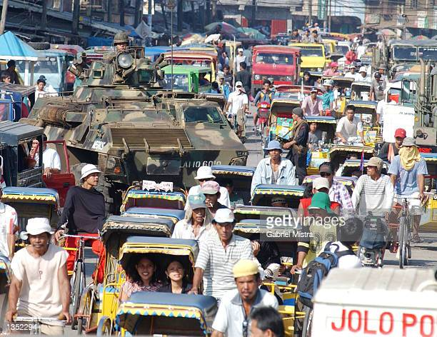 A military personnel carrier secures the streets to avert terrorist attacks from the Abu Sayaf group August 24 2002 in Jolo Philippines Philippine...
