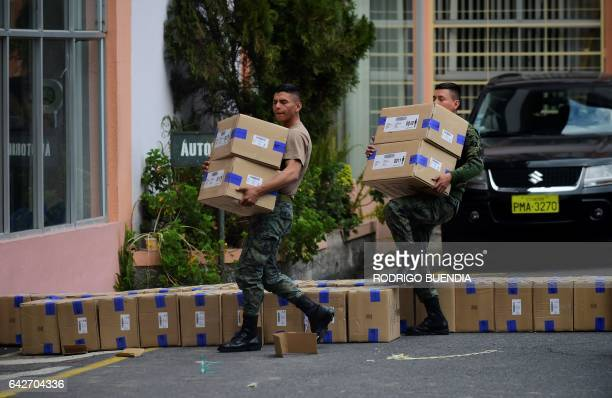 Military personnel deliver electoral kits to polling stations across Quito on February 18 2017 on the eve of the country's presidential election...
