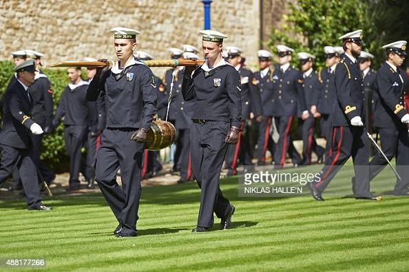 Military personnel from the Dutch Naval ship HNLMS Johan de Witt deliver a barrel of wine representing the dues at the Tower of London in central...