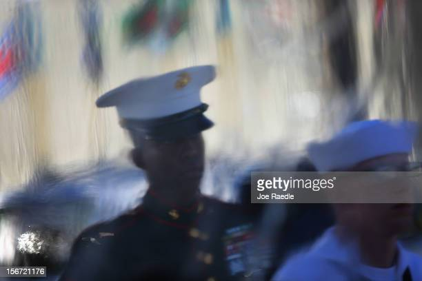 Military personnel from the Joint Color Guard are seen through a plastic sheet before the start of the change of command ceremony at the United...