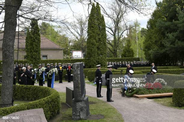 Military personnel lay flower wreaths on the grave of Finland's former President Mauno Koivisto during the burial ceremony at the Hietaniemi cemetary...