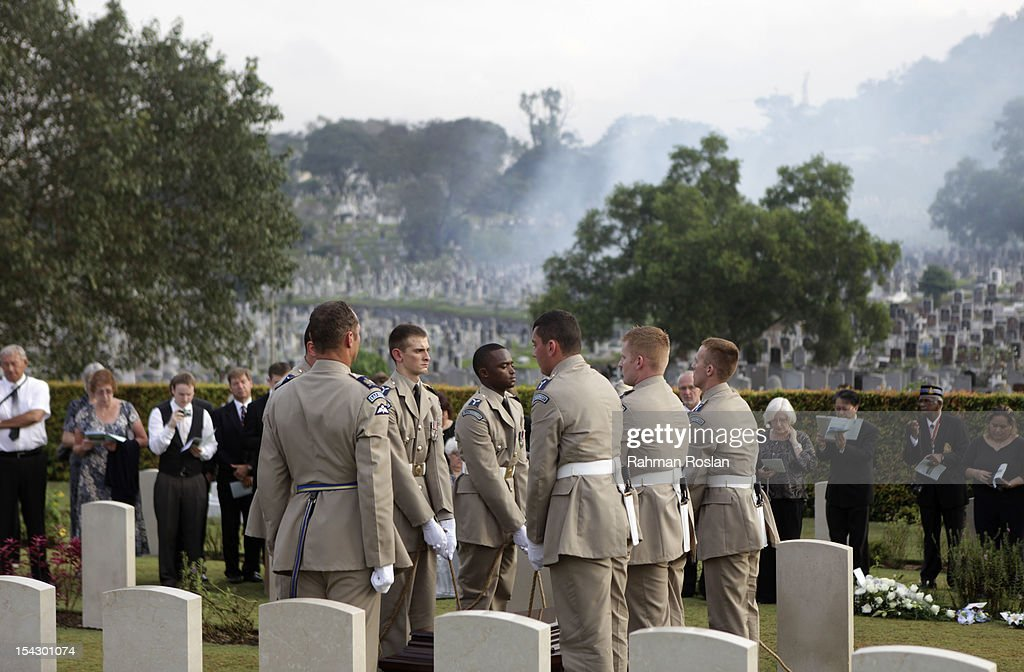 Military personnel lowered the casket during the burial of eight RAF crew members at the Commonwealth War Cemetery on October 18, 2012 in Kuala Lumpur, Malaysia. The eight crew members were flying a B-24 Liberator on August 23, 1945, eight days after Japan surrendered in World War II, when the plane crashed and was lost near Kuala Pilah, Malaysia. The crash site was undiscovered until the 1990s and human remains were found in 2009 after a detailed investigation.