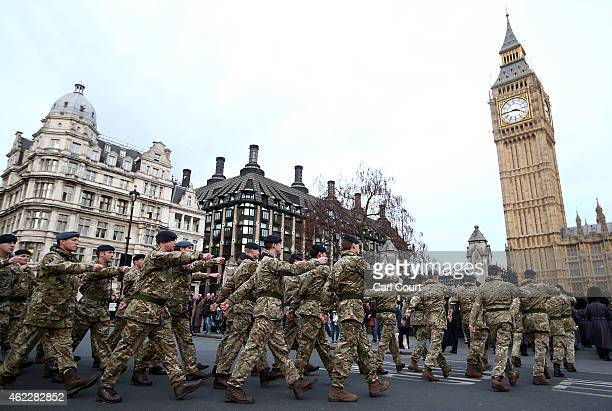 Military personnel march into the Houses of Parliament on January 26 2015 in London England 120 military personnel from all three services were...