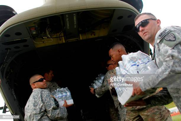 US Military personnel organize aid and supplies for residents affected by the passing of Hurricane Maria in Barranquitas Puerto Rico October 23 2017...