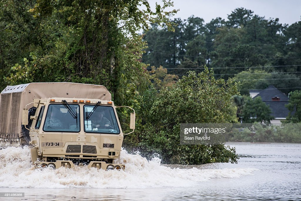 Military personnel respond to flooding in the Forest Acres neighborhood October 5 2015 in Columbia South Carolina The state of South Carolina...