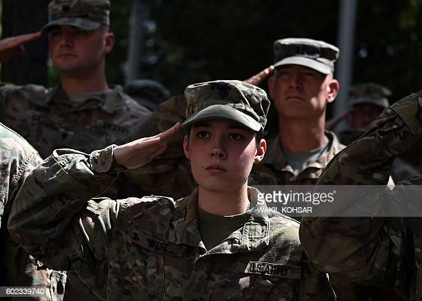 US military personnel salute at a memorial ceremony in honour of the 15th anniversary of the September 11 2001 attacks on New York and Washington DC...