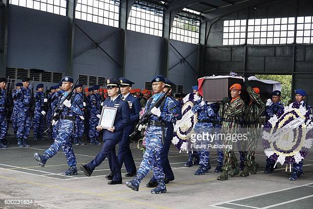 Military personnel seen with the coffin of Captain Jan Hotlan Parlin Saragih on December 19 2016 in Medan Indonesia Captain Jan Hotlan Parlin Saragih...
