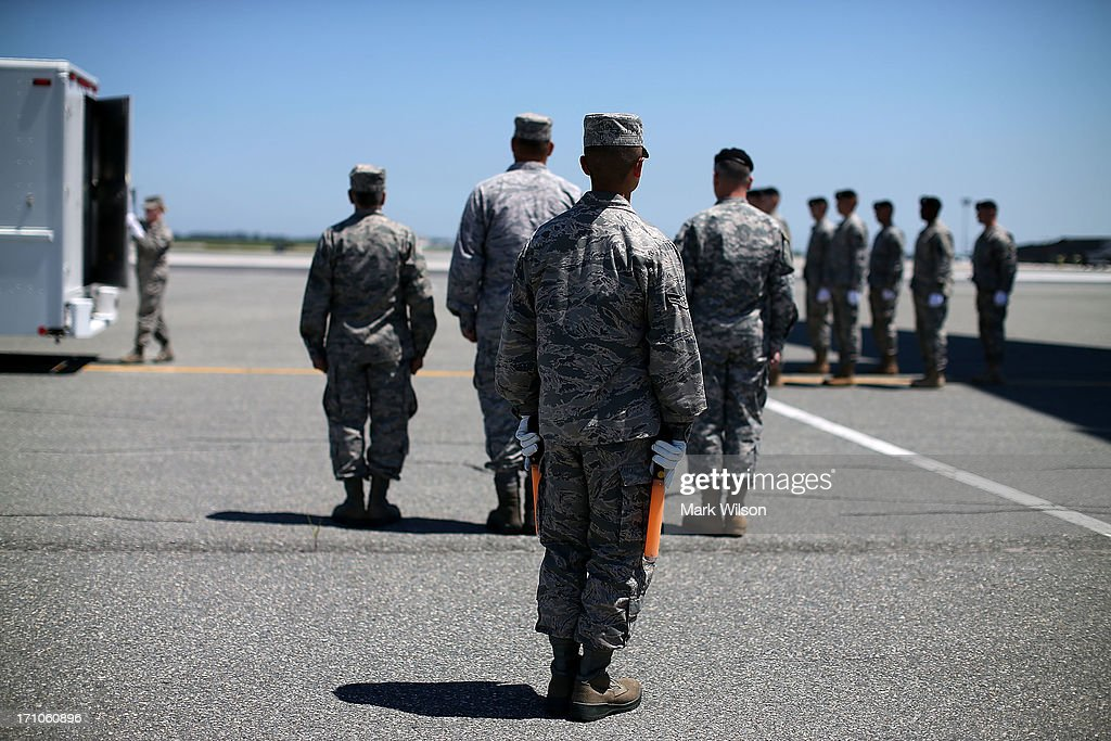 Military personnel stand by as the door is closed on the mortuary truck containing the transfer case of U.S. Army Spc. Ember M. Alt, during a dignified transfer at Dover Air Force Base, on June 21, 2013 in Dover, Delaware. Spc. Alt 21, from Beech Island, S.C., was killed in Bagram , Afghanistan of wounds sustained after enemy forces attacked her unit at the air base there.