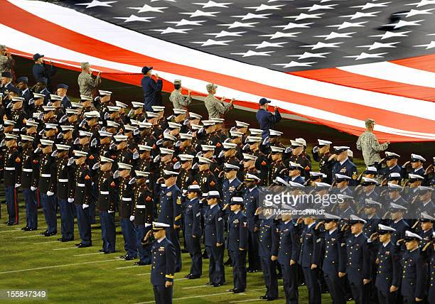 Military personnel stand for the National Anthem as the Indianapolis Colts play against the Jacksonville Jaguars in a NFL Network Thursday Night...