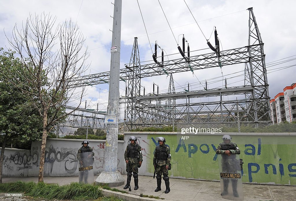 Military personnel stand guard around a substation of Electropaz, a power plant that until now were run by Spain's Iberdrola, in La Paz on December 29, 2012. President Evo Morales announced the nationalization of electrical utilities owned by Spanish company Iberdrola -- yet another expropriation by the populist leader of South America's poorest nation. Morales announced a decree targetting Iberdrola-owned utilities in the cities of La Paz and Oruro -- Electropaz and Elfeo, respectively. AFP PHOTO/Jorge Bernal