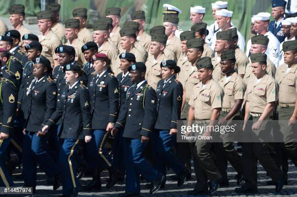 Military personnel take part in Friday's Bastille Day celebrations and military parade on the Avenue des Champs Elysees on July 14 2017 in Paris...