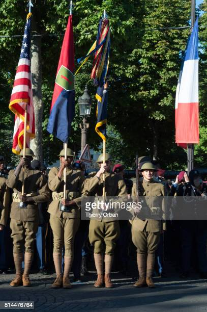 Military personnel take part in Friday's Bastille Day celebrations and military parade on the Avenue des ChampsElysees on July 14 2017 in Paris...