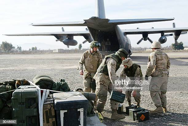 US military personnel unload baggage from a military C130 on the runway at Camp Salerno February 14 2004 in Khost Afghanistan Camp Salerno is the...