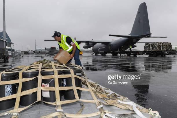 Military personnel unload fire retardant material on February 17 2017 in Christchurch New Zealand The Royal New Zealand Air Force C130 Hercules...